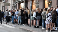 People queue in front of a night club after the coronavirus disease (COVID-19) restrictions for restaurants, bars and…