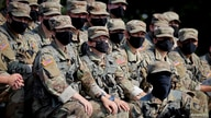 U.S. Military Academy (USMA) cadets wear protective face masks as they take instructions at a Call for Fire range during…