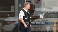 A Chicago Police officer inspects an Apple store that was vandalized in Chicago, Illinois, U.S. August 10, 2020.  REUTERS/Kamil…