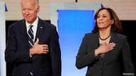 FILE - Former Vice President Joe Biden and U.S. Senator Kamala Harris take the stage before the start of the second night of the second U.S. 2020 presidential Democratic candidates debate in Detroit, Michigan, U.S., July 31, 2019.