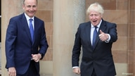 Britain's Prime Minister Boris Johnson and Ireland's Prime Minister (Taoiseach) Micheal Martin are seen at Hillsborough Castle, in Belfast, Northern Ireland, Aug. 13, 2020.