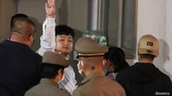 Parit Chiwarak, a pro-democracy student, one of the leaders of Thailand's recent anti-government protests, flashes a three…