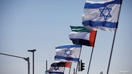 FILE PHOTO: The national flags of Israel and the United Arab Emirates flutter along a highway following the agreement to…