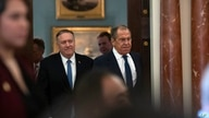 Secretary of State Mike Pompeo, left, follows Russian Foreign Minister Sergey Lavrov to a media availability, after their…