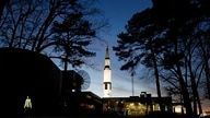 FILE - An employee leaves the state operated U.S. Space & Rocket Center, which serves as the visitor center for the nearby…