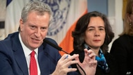 FILE - In this Wednesday, Feb. 26, 2020, file photo, Mayor Bill de Blasio, left, is shown with Dr. Oxiris Barbot, commissioner…