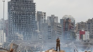 A soldier stands at the devastated site of the explosion in the port of Beirut, Lebanon, Thursday, Aug. 6, 2020. French…
