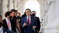 Treasury Secretary Steven Mnuchin, center, leaves following a meeting with House Speaker Nancy Pelosi of Calif. and Senate…