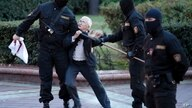 Opposition activist Nina Baginskaya, 73, center, struggles with police during a Belarusian opposition supporters rally at…