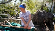 Elaine Rayburn sorts through her belongings at her home on Aug. 27, 2020, in Lake Charles, La.