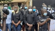 Members of the Union of Journalists and Technicians of the Guinea-Bissau Media, wearing COVID masks, hold a vigil outside Radio Capital FM in Bissau, Guinea-Bissau, Aug. 6, 2020.