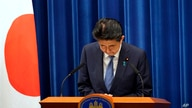 Japanese Prime Minister Shinzo Abe bows during a press conference announcing his resignation, at the prime minister's official residence in Tokyo, Japan, Aug. 28, 2020.