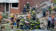 Baltimore City Fire Department carries a person out from the debris after an explosion in Baltimore, Maryland, Aug. 10, 2020.