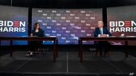 Democratic presidential candidate former Vice President Joe Biden and running mate Senator Kamala Harris look to each other as they sign documents required for their nominations, in Wilmington, Delaware, Aug. 14, 2020.