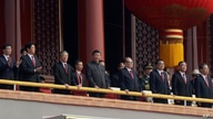 FILE - Chinese President Xi Jinping, center, stands with other Chinese leaders to watch a parade as Communist Party celebrates its 70th anniversary in Beijing, Oct. 1, 2019.