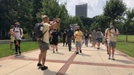 Protesters march opposing in-person classes at Georgia Tech in Atlanta, Aug. 17, 2020. More of the state public universities are opening for the fall term.