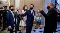 FILE - U.S. Treasury Secretary Steven Mnuchin, center, and White House Chief of Staff Mark Meadows, right, walk out of a meeting with House Speaker Nancy Pelosi and Senate Minority Leader Sen. Chuck Schumer on Capitol Hill in Washington, July 29, 2020.