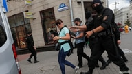 FILE - Law enforcement officers detain journalists in Minsk, Belarus, July 28, 2020.