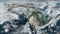 This NOAA handout true-color composite image obtained from NASA on July 29, 2019 shows smoke from Arctic wildfires spreading…