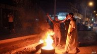 Libyan youth block a road with burning tyres in Libya's eastern coastal city of Benghazi on September 12, 2020, as they protest…