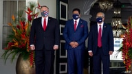 US Secretary of State Mike Pompeo (L) stands next to Surinam's President Chan Santokhi (C) and Surinam's Minister of Foreign…