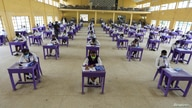 Students of Government Secondary School Wuse, are seen taking the West African Examination Council (WAEC) 2020 exam, after the…