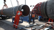 FILE PHOTO: Workers are seen at the construction site of the Nord Stream 2 gas pipeline, near the town of Kingisepp, Leningrad…