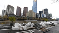 Parts of a decommissioned floating bar and restaurant are seen along the Yarra River as the city operates under lockdown in…