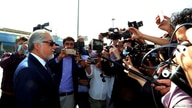 Abdullah Abdullah, Chairman of the High Council for National Reconciliation (L) speaks to media before departing from Kabul,…