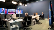 A government photo shows German Chancellor Angela Merkel during a video conference with European Council President Charles…