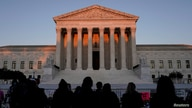 FILE PHOTO: People gather to mourn the death of Associate Justice Ruth Bader Ginsburg at the Supreme Court in Washington, U.S.,…