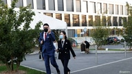 Students walk out of the Ecole Hoteliere de Lausanne after its students were put under quarantine in Lausanne, Switzerland.