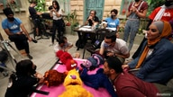 The staff of the children program Ahlan Simsim are seen as they film a scene on the set of the show in a studio in Amman, Jordan, Sept. 20, 2020.