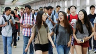 FILE - In this Sept. 9, 2015 file photo, students arrive for the first day of school at Stuyvesant High School in New York. A…