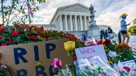 People gather at the Supreme Court on the morning after the death of Justice Ruth Bader Ginsburg, 87, Sept. 19, 2020.