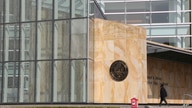 A man walks past the Robert H. Jackson U.S. Courthouse, Tuesday, Sept 22, 2020, in Buffalo N.Y, where Pascale Ferrier is…