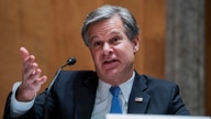 FBI Director Christopher Wray testifies during a Senate Homeland Security and Governmental Affairs Committee hearing on …