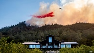 An air tanker drops retardant on the Glass Fire burning above Davis Estates winery in Calistoga, California, Sept. 27, 2020.