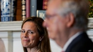 Supreme Court nominee Judge Amy Coney Barrett looks over to Senate Majority Leader Mitch McConnell of Ky., as they meet with on…