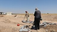 Civilians examining the remains found in an IS mass graves. Families of the Kidnapped by IS seek help from the search and recovery team to find the remains of their loved ones.