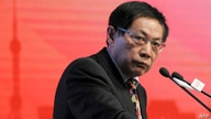 FILE - Ren Zhiqiang, the former chairman of state-owned property developer Huayuan Group, speaks at the China Public Welfare Forum in Beijing, Nov. 18, 2013.