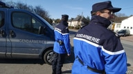 FILE - A French gendarme in Calvados wearing  a blue Gore-Tex jacket, Feb. 28, 2005.