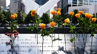 Flowers are seen placed into the groves of inscribed names of the victims of the 9/11 terrorist attacks, at the National September 11 Memorial and Museum, Sept. 11, 2020, in New York City.
