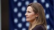 FILE - Judge Amy Coney Barrett listens as President Donald Trump announces Barrett as his nominee to the Supreme Court, in the Rose Garden at the White House, in Washington, Sept. 26, 2020.