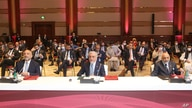 Abdullah Abdullah, center, chairman of Afghanistan's High Council for National Reconciliation, attends the opening session of peace talks between the Afghan government and the Taliban, in Doha, Qatar, Sept. 12, 2020.