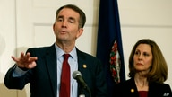 FILE - Virginia Gov. Ralph Northam, left, gestures as his wife, Pam, listens during a news conference in the Governors Mansion at the Capitol in Richmond, Virginia, Feb. 2, 2019.