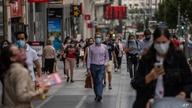 Pedestrians wearing face masks to prevent the spread of coronavirus walk in downtown Madrid, Spain, Sept. 17, 2020.
