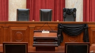 The Bench is seen draped for the death of Supreme Court Associate Justice Ruth Bader Ginsburg at the Supreme Court in Washington, Sept. 19, 2020. (Credit: Supreme Court of the United States)