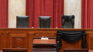 The Bench is seen draped for the death of Supreme Court Associate Justice Ruth Bader Ginsburg at the Supreme Court in Washington, D.C., Sept. 19, 2020. (Credit: The Supreme Court of the United States)