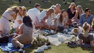 FILE - People picnic during the annual Midsummer celebrations in Stockholm, Sweden, June 19, 2020.